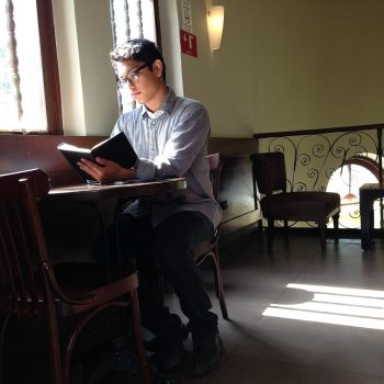 Student Reading In Cafe